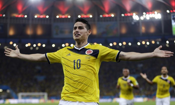 FILE - In this June 28, 2014, file photo, Colombia's James Rodriguez celebrates after scoring the opening goal during the World Cup round of 16 soccer match between Colombia and Uruguay at the Maracana Stadium in Rio de Janeiro, Brazil. Never before has the star-crossed nation made the quarterfinals. There is even waxing poetic about World Cup unity accelerating the pace of 18-month-old peace talks to end a half-century of conflict that has claimed some 220,000 lives. (AP Photo/Natacha Pisarenko)