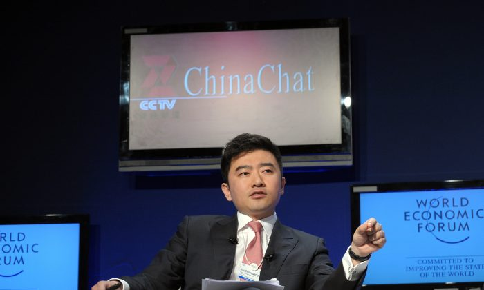 Rui Chenggang, anchor of China Central Televison (CCTV), talks during a CCTV televised debate focusing on China's growth at the World Economic Forum on January 29, 2010 in Davos. Rui was taken away by governmental anti-corruption organization for investigation on July 11, 2014. (Eric Piermont/AFP/Getty Images)