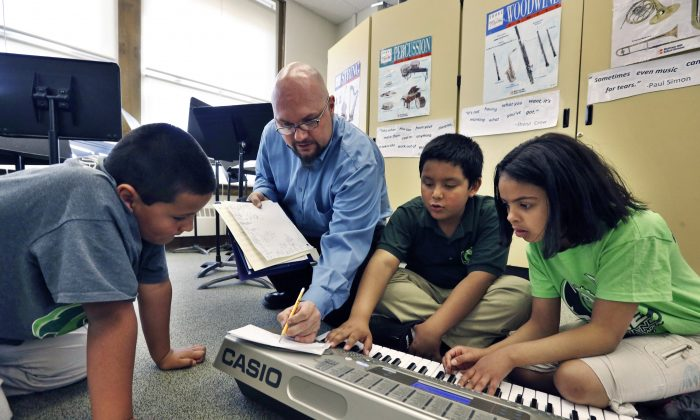 Students learn music composition at Cole Elementary school in Denver, Colo., April 22. (Brennan Linsley/AP)