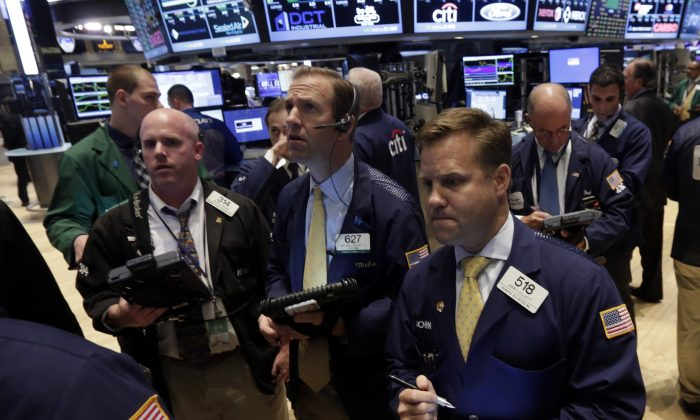 Traders work on the floor of the New York Stock Exchange Tuesday, July 1, 2014. (AP Photo/Richard Drew)
