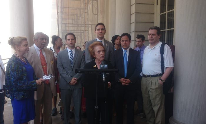 Federal, state, and city officials stand by residents who would be required to move to smaller units under the city Department of Housing and Preservation and Development's mandated downsizing of overhoused units at City Hall, July 2, 2014. (Catherine Yang/Epoch Times)
