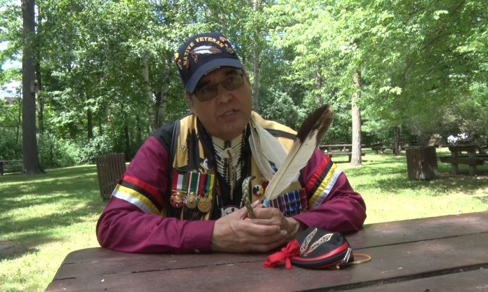 Earl Robert Crane speaks on the relationship between Canada and its original peoples during the Aboriginal Festival and Competition Powwow in Ottawa in June 2014. Crane believes Aboriginal Peoples are nearing a time when they can assert their legal rights in a more significant way. (Matthew Little/Epoch Times)