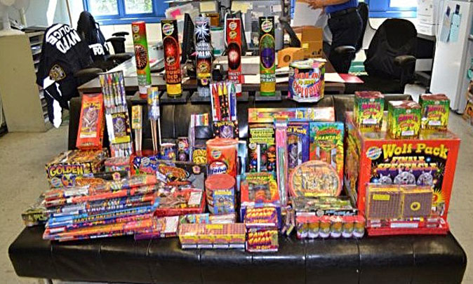 A large assortment of illegal fireworks is displayed on a table in New York, July 3, 2013. The fireworks valued at $1,600 were seized when police arrested two individuals in the Bronx borough of New York who were trying to sell them on Craigslist. (AP Photo/New York Police Department)