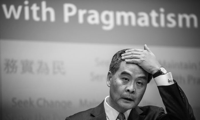 Hong Kong Chief Executive Leung Chun-ying addresses a press conference after his maiden policy address in Hong Kong on Jan. 16, 2013. Hong Kong's China-backed leader plans to tackle the city's housing crisis in a policy speech aimed at soothing anger following a series of mass protests urging him to quit. (AFP photo/Philippe Lopez)