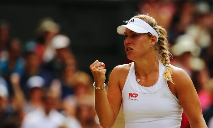 Angelique Kerber of Germany celebrates during her Ladies' Singles fourth round match against Maria Sharapova of Russia on day eight of the Wimbledon Lawn Tennis Championships at the All England Lawn Tennis and Croquet Club on July 1, 2014 in London, England. (Al Bello/Getty Images)