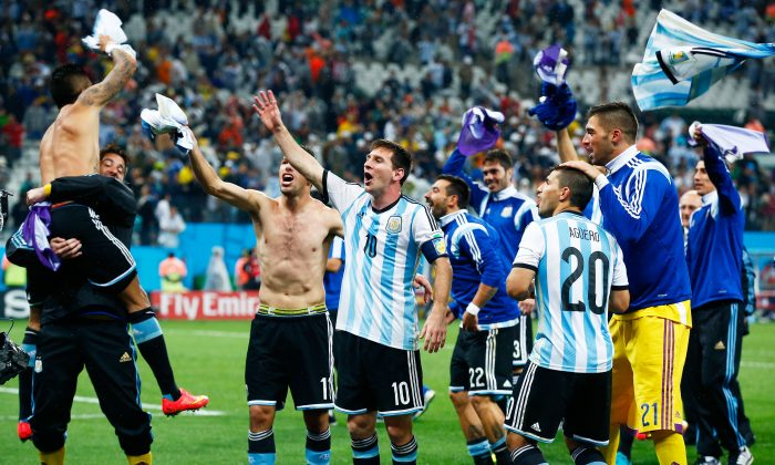 Argentina's Lionel Messi rejoices with his teammates after defeating Netherlands in a semifinal penalty shootout in Sao Paulo on July 9, 2014. (Clive Rose/Getty Images)