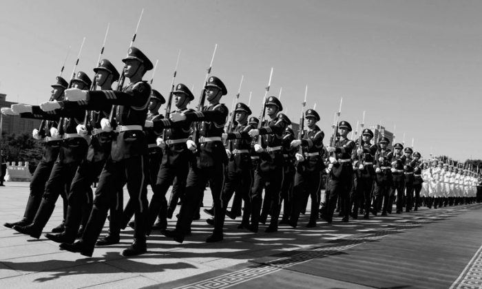 Chinese military troops march before U.S. Secretary of Defense, Leon Panetta, at the Bayi Building in Beijing, China, 2012. (Larry Downing/Getty Images)