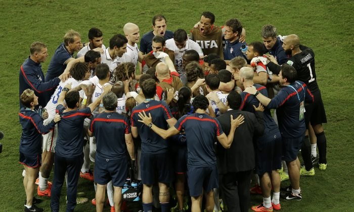 The U.S. team huddles before the beginning of the extra time during the World Cup round of 16 soccer match between Belgium and the USA in Salvador, Brazil, on July 1, 2014. (AP Photo/Themba Hadebe)