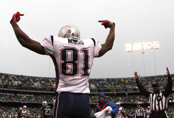 Randy Moss #81 of the New England Patriots celeberates after scoring a touchdwon against the Oakland Raiders during an NFL game on December 14, 2008 at the Oakland-Alameda County Coliseum in Oakland, California. (Jed Jacobsohn/Getty Images)