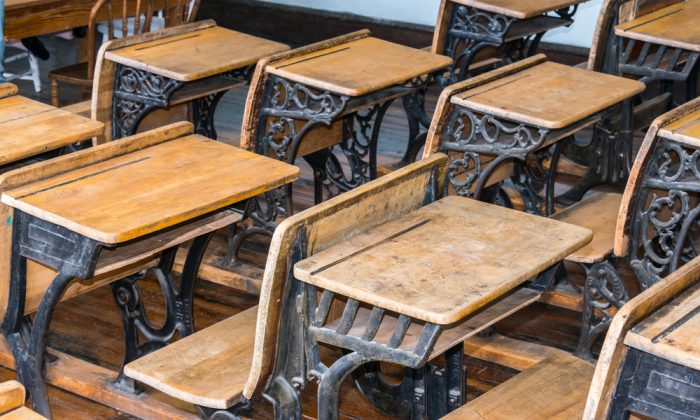 A stock photo shows a classroom (*Shutterstock)