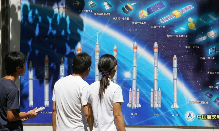 People look at a display of China's rockets and space program on Aug. 29, 2007, in a Beijing park. The Chinese regime recently tested an anti-satellite missile. (Frederic J. Brown/AFP/Getty Images)
