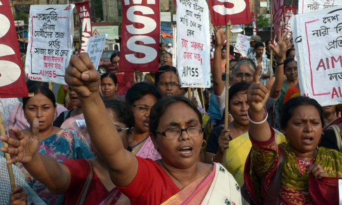 Indian activists from the Social Unity Center of India (SUCI) shout slogans against the state government in protest against the gang-rape and murder of two girls in the district of Badaun in the northern state of Uttar Pradesh and recent rapes in the eastern state of West Bengal, in Kolkata on June 7, 2014. (Dibyangshu Sarkar/AFP/Getty Images)