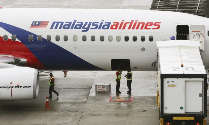 Evidence indicates mh370 flight crash was deliberate says ground crew stand near a malaysia airlines aircraft on the tarmac at the kuala lumpur international airport klia in sepang malaysia tuesday may 27 publicscrutiny Gallery