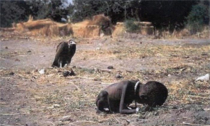 A vulture waits for this child to die of hunger in Africa.