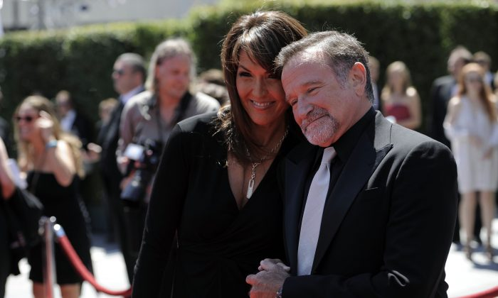 Robin Williams and Susan Schneider, who went on to become his third wife, arrive at the Creative Arts Emmy Awards on Saturday, Aug. 21, 2010 in Los Angeles. (AP Photo/Chris Pizzello)