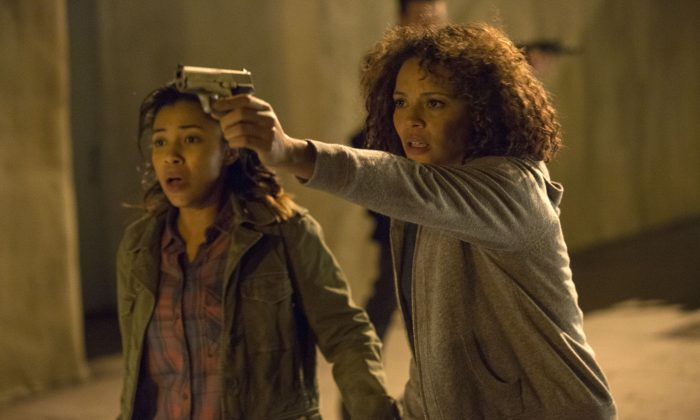 "This image released by Universal Pictures shows Zoe Soul, left, and Carmen Ejogo in a scene from ""The Purge: Anarchy."" (AP Photo/Universal Pictures, Justin Lubin)"