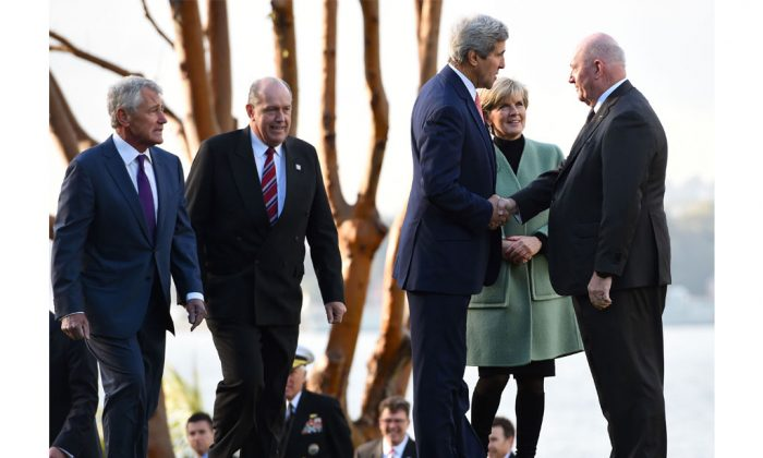 Secretary of State John Kerry (3rd-R), along with US Secretary of Defense Chuck Hagel (L), Australian Defense Minister David Johnston (2nd-L), and Australian Foreign Minister Julie Bishop (2nd-R) are greeted by Governor-General Sir Peter Cosgrove (R) at Admiralty House on Aug. 12, 2014 in Sydney, Australia. (Dan Himbrechts/Getty Images)