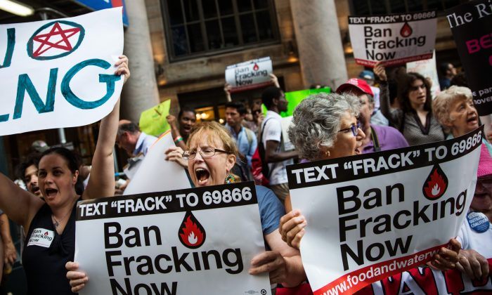 Protesters demand a statewide ban on fracking outside of a Manhattan hotel where Gov. Cuomo was attending a Democratic Party event in New York on June 30, 2014. (Andrew Burton/Getty Images)