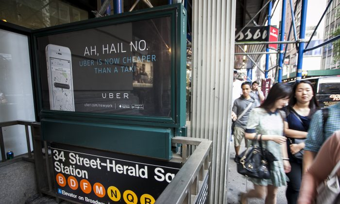 An Uber advertisement on top of the Herald Square subway entrance in Manhattan, New York City, on Aug. 20, 2014. (Samira Bouaou/Epoch Times)