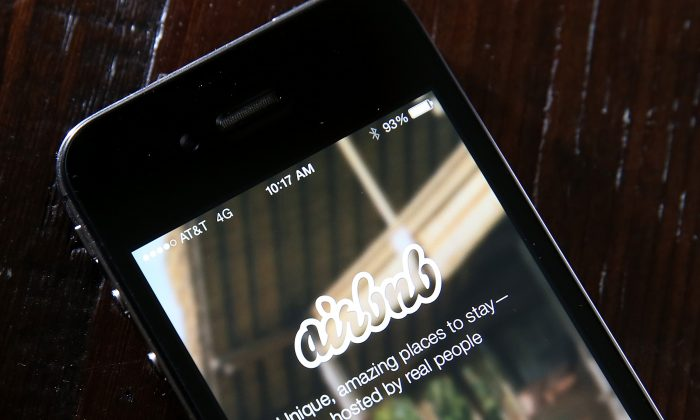 A smartphone displaying the Airbnb app. (Justin Sullivan/Getty Images)