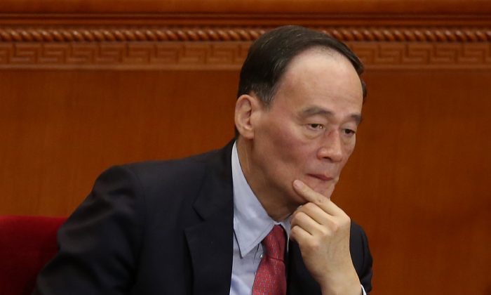 Anti-corruption chief Wang Qishan attends the opening session of the National People's Congress (NPC) at the Great Hall of the People on March 5, 2014 in China. (Feng Li/Getty Images)
