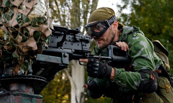 A Pro-Russia rebel prepares arms for the the assault on the positions of Ukrainian army in Donetsk airport, eastern Ukraine, on Aug. 31, 2014.  (AP Photo/Mstislav Chernov)