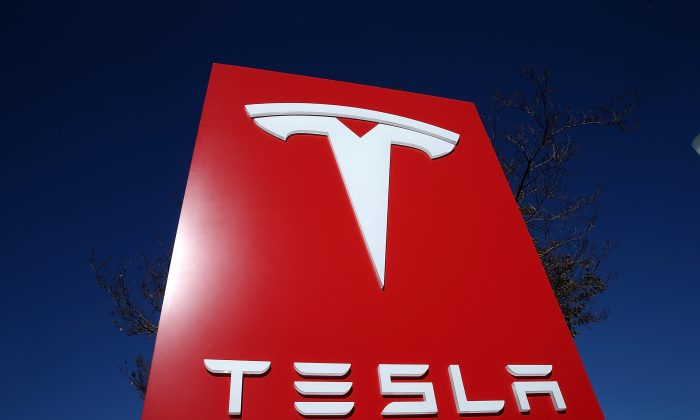 A sign is posted at a Tesla showroom on November 5, 2013, in Palo Alto, California. (Justin Sullivan/Getty Images)