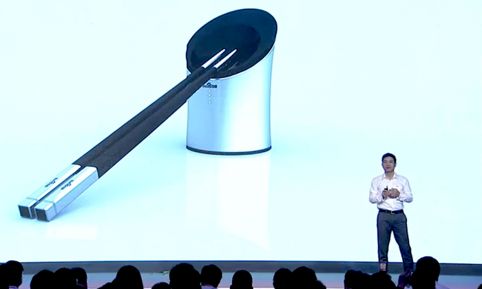Robin Li, chairman and chief executive officer of Baidu Inc., introduces the Smart Chopsticks at the Baidu Technology Innovation Conference 2014 in Beijing on Sept. 3, 2014. The device was invented in response to the regular food safety scandals in China. (Screenshot/Baiduworld)