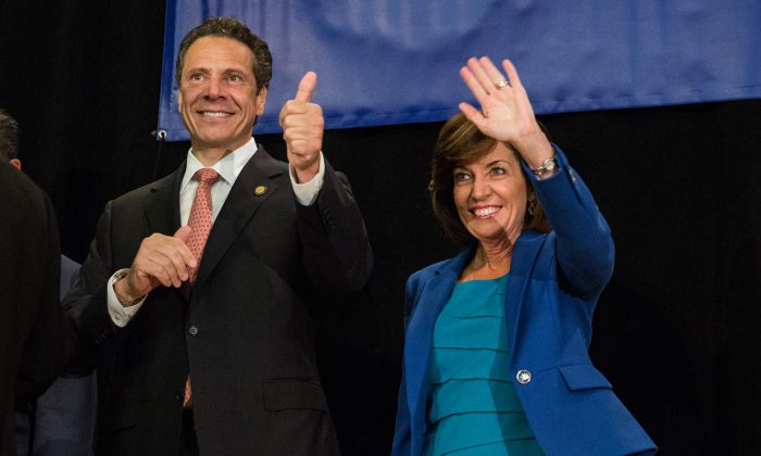 New York Gov. Andrew Cuomo (L) and his choice for lieutenant governor, former congresswoman Kathy Hochul, campaign together at the Hotel Trades Council during a reelection campaign event in New York City on Sept. 8, 2014. (Andrew Burton/Getty Images)