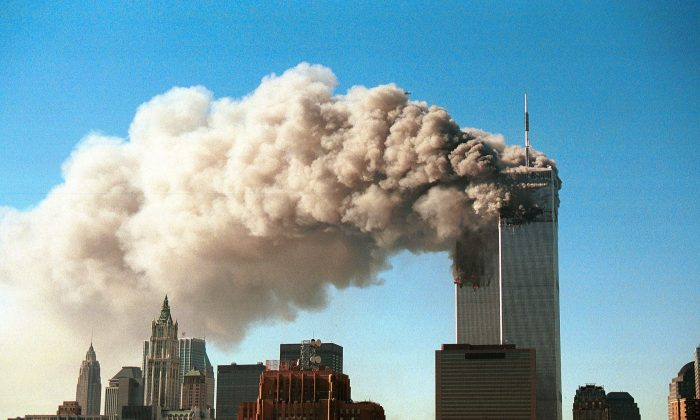 9/11: Smoke pours from the twin towers of the World Trade Center after they were hit by two hijacked airliners in a terrorist attack in New York on Sept. 11, 2001. (Robert Giroux/Getty Images)