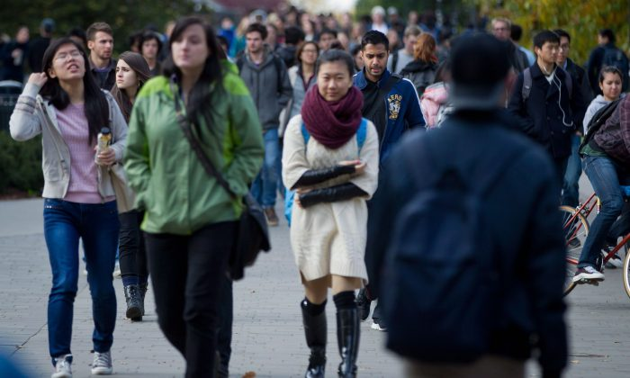 Students walk on the University of British Columbia campus on Oct. 30, 2013. Adolescent mental illness is a growing concern in Canada's education system. (The Canadian Press/Darryl Dyck)