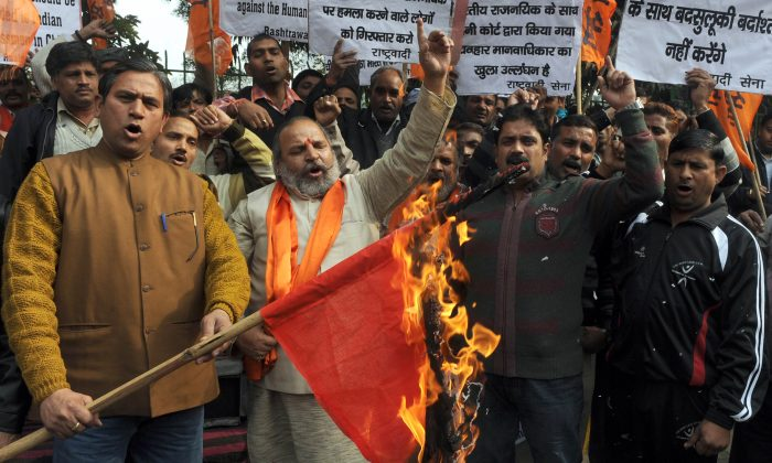 Activists of the Indian right-wing Hindu organization Shiv Sena shout slogans as they burn a China national flag while protesting land grabs by China in Ladakh during a demonstration in Amritsar on April 25, 2013. On Monday, the Chinese army again transgressed into the Ladakh region just days before Chinese leader Xi Jinping's scheduled visit to India. (Narinder Nanu/AFP/Getty Images)
