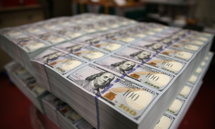 Newly redesigned $100 notes at the Bureau of Engraving and Printing, in Washington, on May 20, 2013. According to James Grant, Federal Reserve notes are a form of debt, rather than money. (Getty Images)