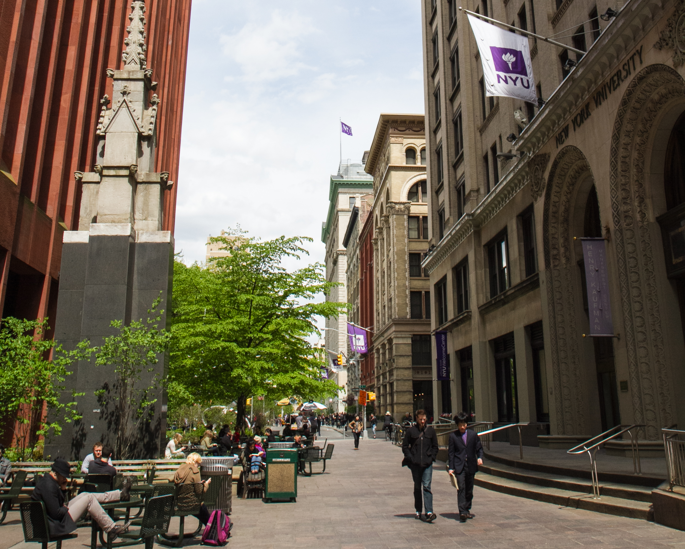 People walk on the NYU campus in New York City on April 24, 2012. (Benjamin Chasteen/The Epoch Times)