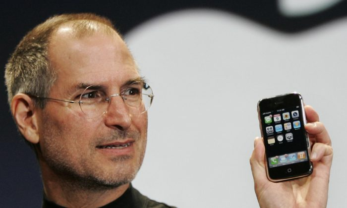 Apple CEO Steve Jobs demonstrates the new iPhone during his keynote address at MacWorld Conference in this 2007 file photo. (AP Images)