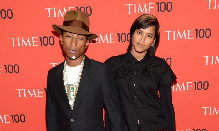 Pharrell Williams, left, and Helen Lasichanh arrive at 2014 TIME 100 Gala held at Frederick P. Rose Hall, Jazz at Lincoln Center, on Tuesday, April 29, 2014, in New York. (Evan Agostini/Invision/AP)
