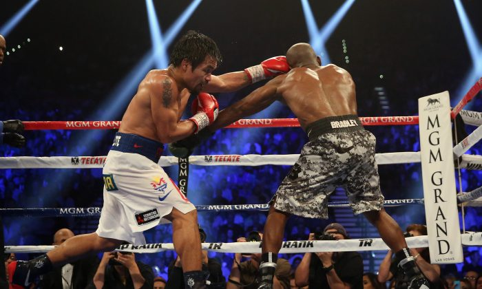 Manny Pacquiao throws a left hand at Timothy Bradley at the MGM Grand Garden Arena on April 12, 2014 in Las Vegas, Nevada. (Photo by Jeff Gross/Getty Images)