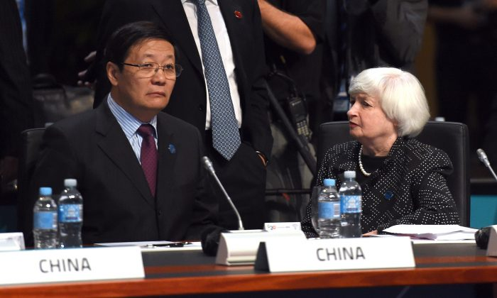 China's finance minister Lou Jiwei talks with U.S. Federal Reserve chair Janet Yellen at the G20 Finance Ministers and Central Bank Governors Meeting in Cairns, Australia, on Sept. 20, 2014. (William West/AFP/Getty Images)