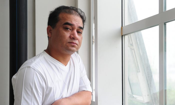 "University professor, blogger, and member of the Muslim Uighur minority, Ilham Tohti pauses before a classroom lecture in Beijing on June 12, 2010. State-run Xinhua news agency has complained that Western news media were referring to Tohti, recently given a sentence of life in prison for ""separatism,"" as ""China's Mandela."" (Frederic J. Brown/AFP/Getty Images)"