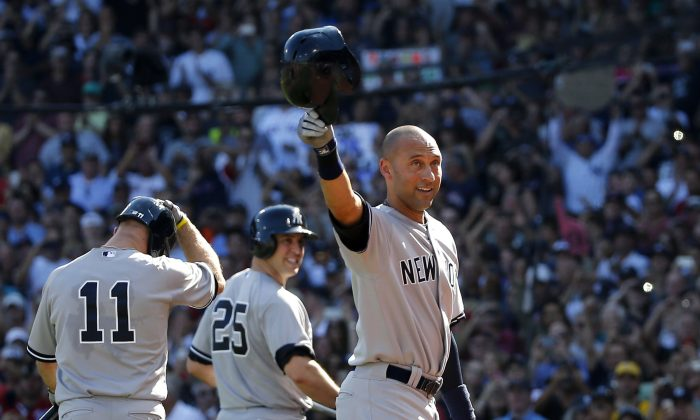 New York Yankees designated hitter Derek Jeter tips his cap to the crowd at Fenway Park after coming out of the baseball game for a pinch-runner in the third inning against the Boston Red Sox in a baseball game Sunday, Sept. 28, 2014, in Boston. It is the last baseball game of his career. At left are teammates Brett Gardner (11) and Mark Teixeira (25). (AP Photo/Elise Amendola)