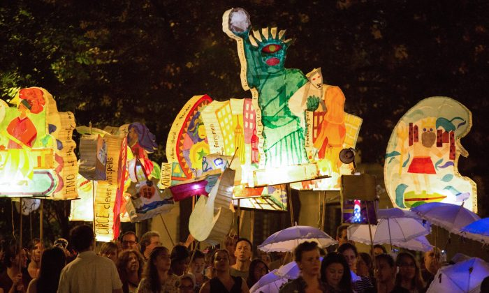 "Hundreds carry illuminated lanterns created by community members of Morningside Heights and Harlem, relating Homer's ""The Odyssey"" to their own neighborhood and experiences, through Morningside Park, Manhattan, N.Y., on Sept. 27, 2014. (Laura Cooksey)"