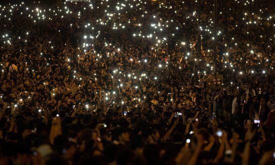 Protesters wave their cell phones in the air in the streets outside the Hong Kong Government Complex on September 29, 2014 in Hong Kong. The information of Hong Kong protest has been blocked in mainland China, but many mainland Chinese still made their voice out to support on the internet. (Chris McGrath/Getty Images)