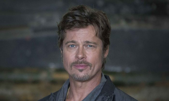 U.S actor Brad Pitt poses, during a photo call for the film, Fury, at the Tank museum, in Bovington, Dorset, southern England, Thursday, Aug. 28, 2014. Pitt married actress Angelina Jolie on Saturday in Chateau Miraval, France, says a spokesman for the couple. (Photo by Joel Ryan/Invision/AP)