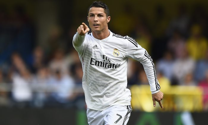Real Madrid's Portuguese forward Cristiano Ronaldo celebrates after scoring during the Spanish league football match Villarreal CF vs Real Madrid CF at El Madrigal stadium in Villareal on September 27, 2014. (JOSE JORDAN/AFP/Getty Images)