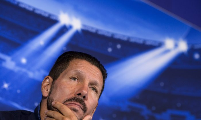 Atletico Madrid's Argentinian coach Diego Simeone gives a press conference at Vicente Calderon stadium in Madrid on September 30, 2014, on the eve of the UEFA Champions League football match Club Atletico de Madrid and Juventus FC. (DANI POZO/AFP/Getty Images)