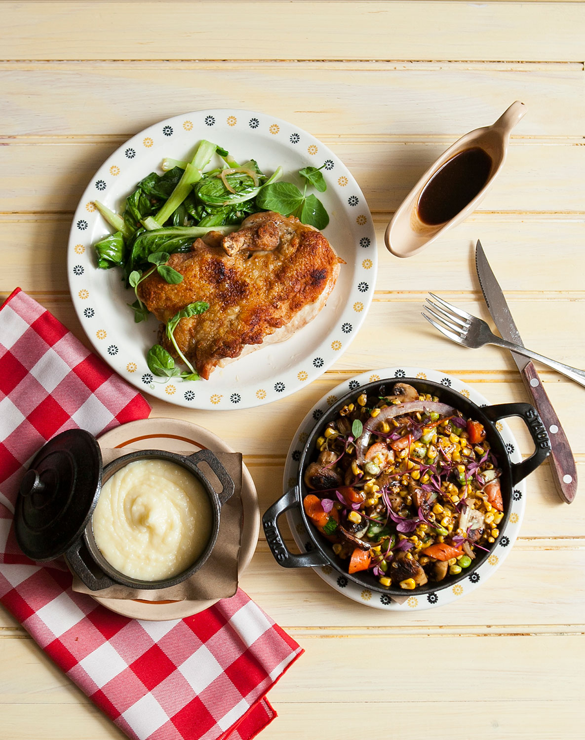 Pan-fried chicken, with Chinese greens, mashed potatoes, and succotash. (Samira Bouaou/Epoch Times)