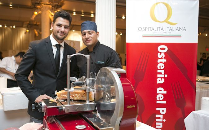 Massimiliano Cortese (L), manager at Osteria del Principe with a staff member at Ospitalità Italiana. The event, held at the Metropolitan Pavillion on Sept. 23, showcased authentic Italian cuisine. (Samira Bouaou/Epoch Times)