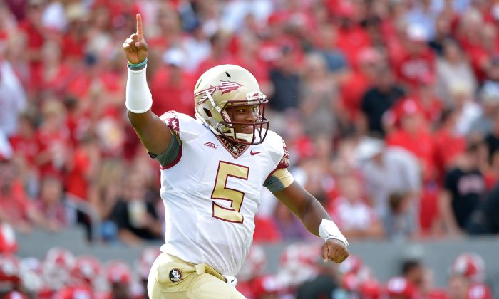 Jameis Winston of Florida State threw for 365 yard and 4 TDs in the Seminoles' come-from-behind win over N.C. State. (Grant Halverson/Getty Images)
