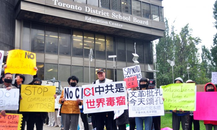 People demonstrate against the Toronto School Board's partnership with the Beijing-controlled Confucius Institute outside the TDSB on Oct. 1, 2014. A committee has voted in favour terminating the TDSB's Confucius Institute program. The issue will now go before the entire board for a vote at the end of the month. (Allen Zhou/Epoch Times)