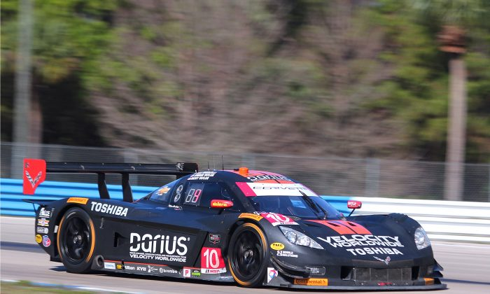 The #10 WTR Dallara-Corvette exits Turn Nine during the 2014 Sebring 12 Hours. The #10 was quickest in the first practice session for the 17th Petit Le Mans at Road Atlanta, Thursday, Oct. 2, 2014. (Chris Jasurek/Epoch Times)